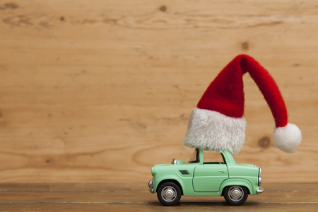 LONDON, UK - DECEMBER 30th 2016: Christmas background concept. Toy car with a Santa hat Editorial