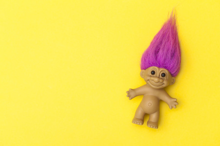 LONDON, UK - DECEMBER 4th 2017: An original troll plastic toy figure with bright coloured hair. First produced in Denmark by Thomas Dam Publikacyjne
