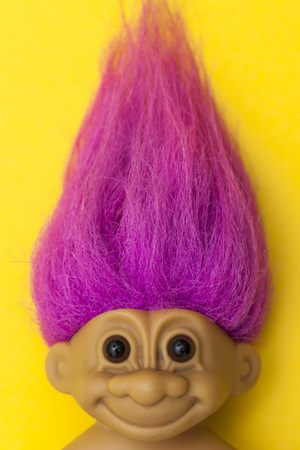 LONDON, UK - DECEMBER 4th 2017: An original troll plastic toy figure with bright coloured hair. First produced in Denmark by Thomas Dam Editorial
