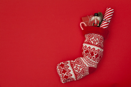 Christmas stocking with cracker, toy and wrapped present