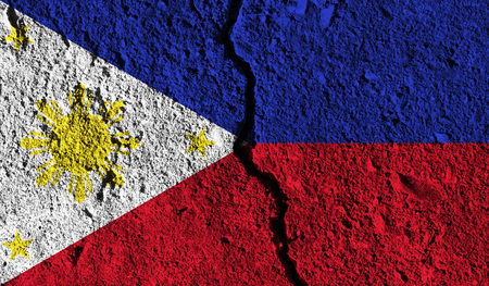 Philippines flag with crack through the middle. Country divided concept