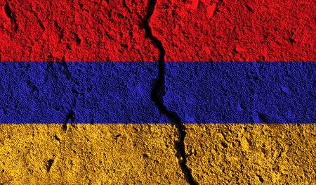Armenia flag with crack through the middle. Country divided concept Stock Photo