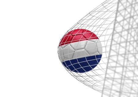 Netherlands flag soccer ball scores a goal in a net Stock Photo