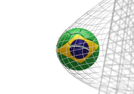 Brazil flag soccer ball scores a goal in a net