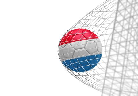 Luxembourg flag soccer ball scores a goal in a net Stok Fotoğraf