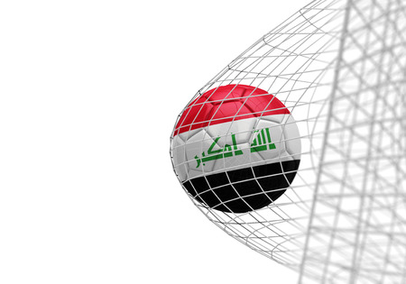 Iraq flag soccer ball scores a goal in a net