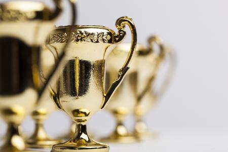 Gouden winnaars prestatie trofee achtergrond Stockfoto