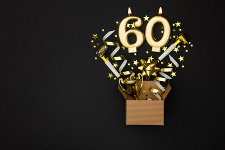 Number 60 gold celebration candle and gift box background Stock Photo - 91935197
