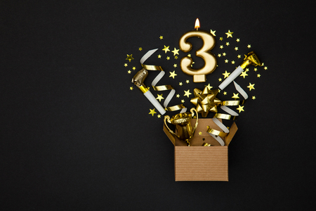 Number 3 gold celebration candle and gift box background 스톡 콘텐츠