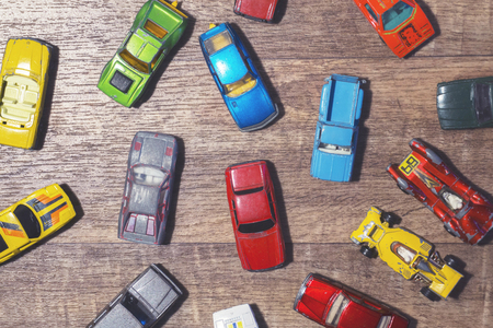 vintage toy cars on a wooden background