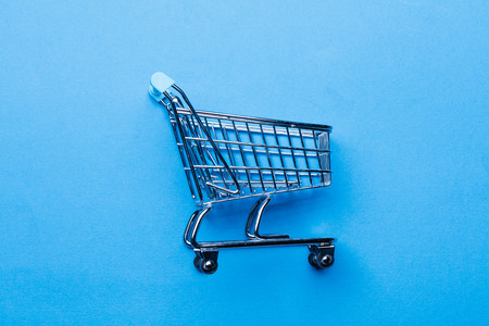 Shopping cart on a blue background Stock Photo