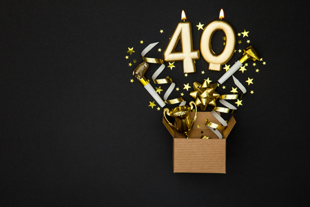 Number 40 gold celebration candle and gift box background