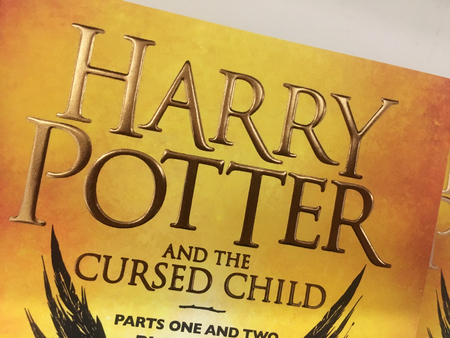 A close up of the front cover of Harry Potter and the cursed child book