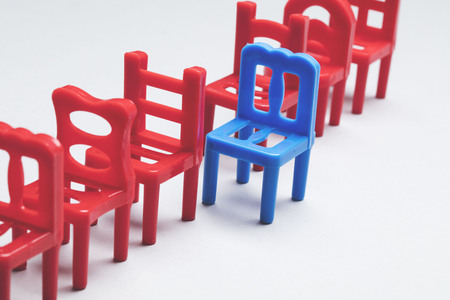 Row of chairs with one odd one out. Job opportunity. Business leadership. recruitment concept. Stockfoto