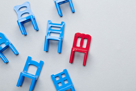Collection of chairs with one odd one out.