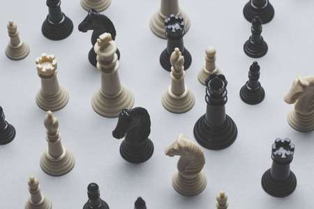 Chess game pieces on a grey background. Strategy concept 写真素材