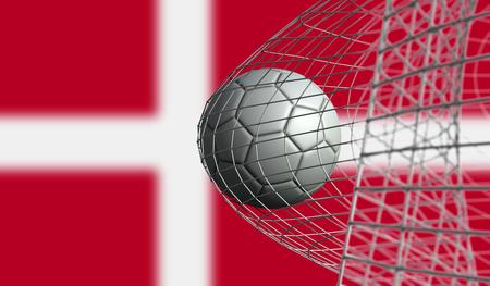 Soccer ball scores a goal in a net against Denmark flag. 3D Rendering Stock Photo