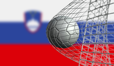 Soccer ball scores a goal in a net against Slovenia flag. 3D Rendering
