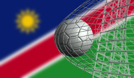 Soccer ball scores a goal in a net against Namibia flag. 3D Rendering