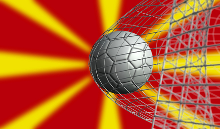 Soccer ball scores a goal in a net against Macedonia flag. 3D Rendering Stock Photo
