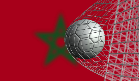 Soccer ball scores a goal in a net against Morocco flag. 3D Rendering Stock Photo