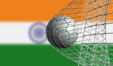 Soccer ball scores a goal in a net against India flag. 3D Rendering Stock Photo
