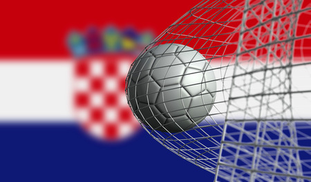 Soccer ball scores a goal in a net against Croatia flag. 3D Rendering Stock Photo