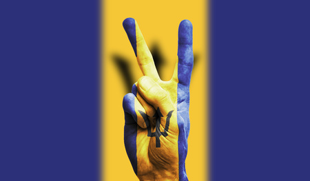 barbados national flag painted onto a male hand showing a victory, peace, strength sign