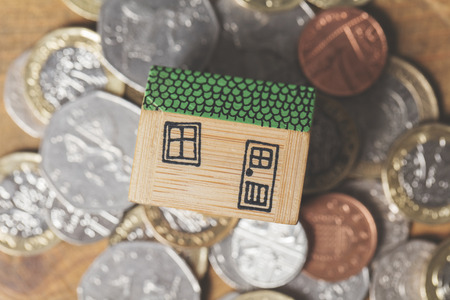 House model with coins. Home finance concept