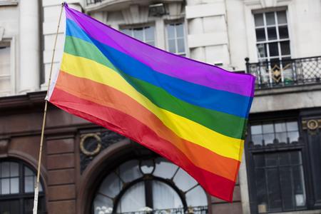 Gay rainbow flag at an LGBT gay pride march in London