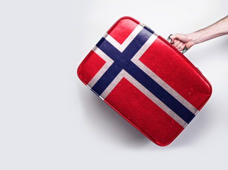 Norway flag on a vintage leather suitcase.
