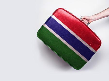 Gambia flag on a vintage leather suitcase.