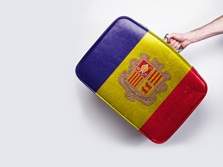 Andorra flag on a vintage leather suitcase. Stock Photo