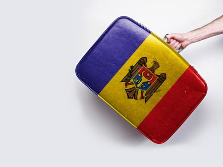 Moldova flag on a vintage leather suitcase.