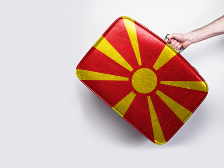 Macedonia flag on a vintage leather suitcase.