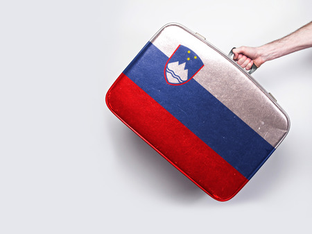 Slovenia flag on a vintage leather suitcase.
