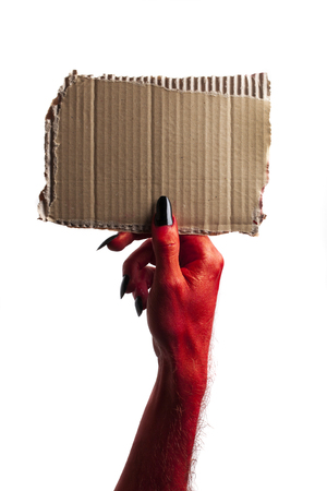 Red halloween monster hand holding blank card sign Stock Photo