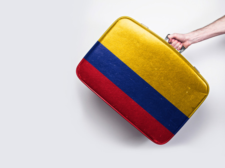 Colombia flag on a vintage leather suitcase.