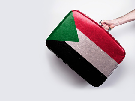 Sudan flag on a vintage leather suitcase.