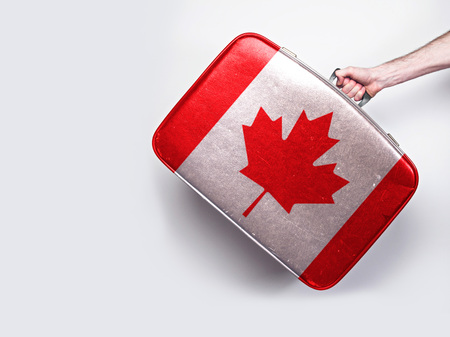 Canada flag on a vintage leather suitcase.