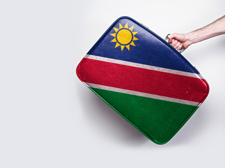 Namibia flag on a vintage leather suitcase. 스톡 콘텐츠