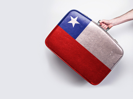 Chile flag on a vintage leather suitcase.