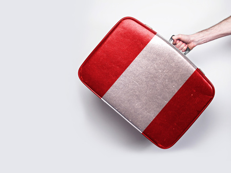 peru flag on a vintage leather suitcase. Stock Photo