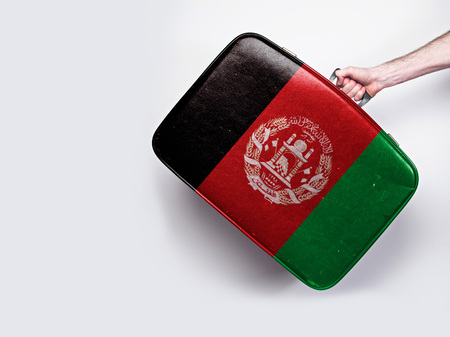 Afghanistan flag on a vintage leather suitcase. Stock Photo