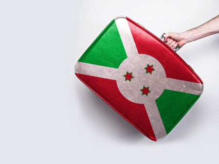 Burundi flag on a vintage leather suitcase.