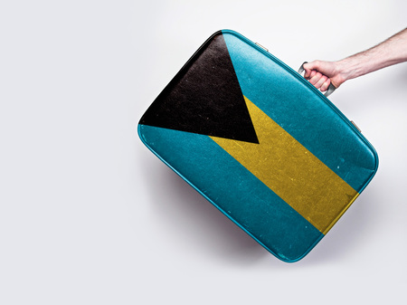 Bahamas flag on a vintage leather suitcase.