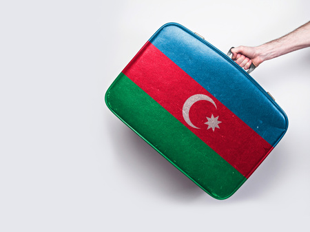 Azerbaijan flag on a vintage leather suitcase.