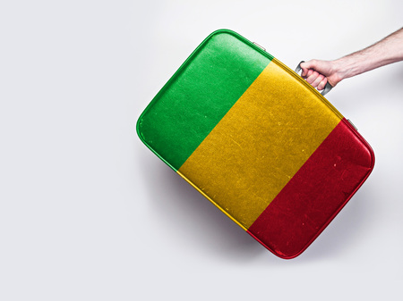 Mali flag on a vintage leather suitcase.