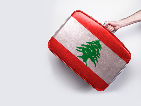 Lebanon flag on a vintage leather suitcase. Stock Photo