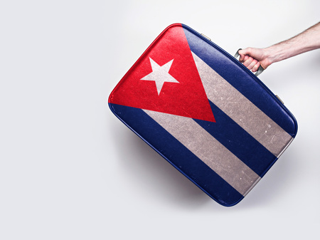 Cuba flag on a vintage leather suitcase.